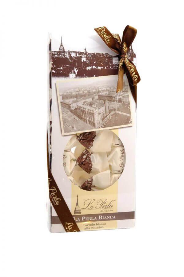 helles schokoladekonfekt mit haselnusssplittern von la perla di torino aus turin in 210 gramm verpackung